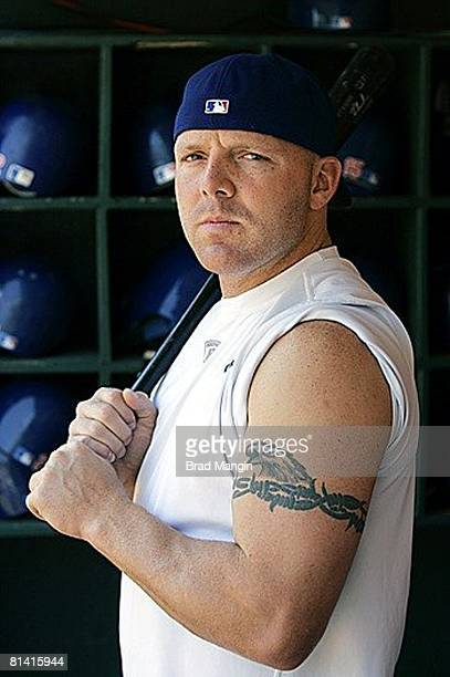 Baseball Closeup casual portrait of Texas Rangers Kevin Mench in dugout showing his tattoo before game vs Oakland Athletics Oakland CA 7/16/2005