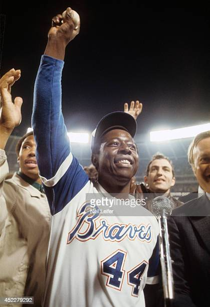 Closeup of Atlanta Braves Hank Aaron victorious with 715th career home run ball after breaking Babe Ruth's record during game vs Los Angeles Dodgers...