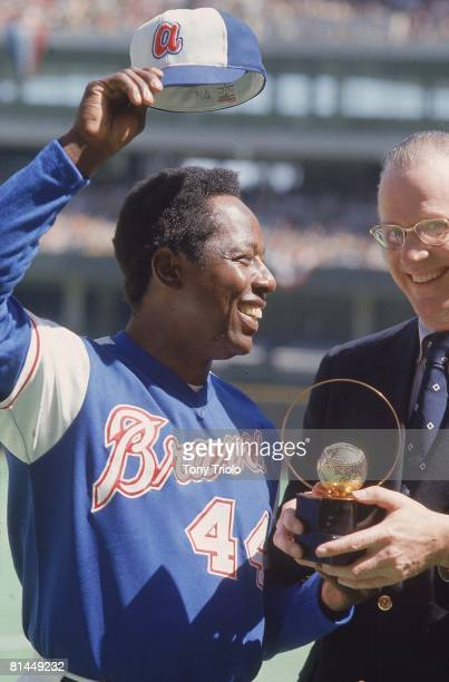 Baseball Closeup of Atlanta Braves Hank Aaron with commissioner Bowie Kuhn victorious after hitting 714th career home run and tying Babe Ruth's...
