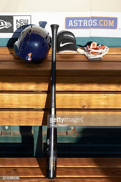 Closeup of bat batting helmet and fielding glove of Houston Astros Jose Altuve in dugout during game vs Boston Red Sox at Minute Maid Park Equipment...