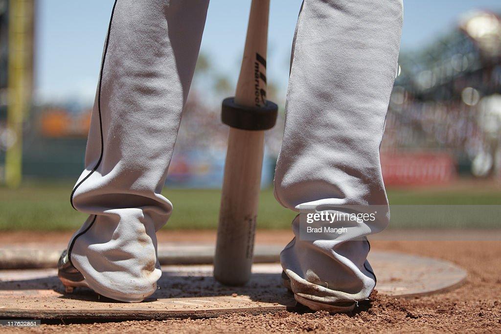 Closeup of feet of Florida Marlins Emilio Bonifacio (1) with bat in on-deck circle vs San Francisco Giants at AT&T Park. Equipment. Brad Mangin F148 )