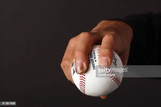Baseball Closeup of hand of New York Yankees pitcher ChienMing Wang demonstrating sinker grip on ball equipment at Kauffman Stadium Kansas City MO...