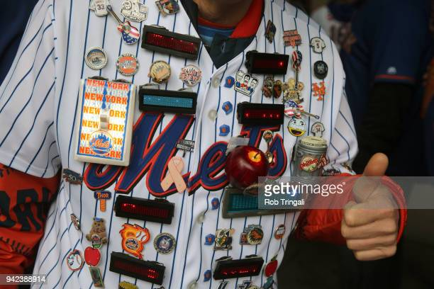 Closeup of New York Mets fan PIN MAN wearing his personalized jersey with several pins attached before game vs St Louis Cardinals at Citi Field...
