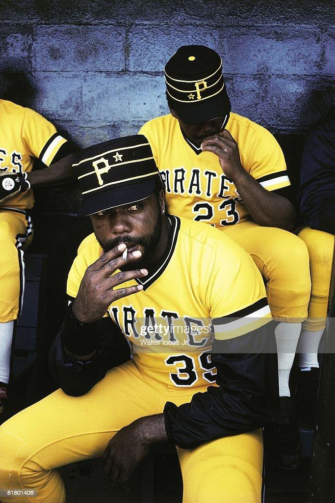 Closeup of Pittsburgh Pirates Dave Parker smoking in dugout during spring training, Bradenton, FL 3/1/1980--3/31/1980