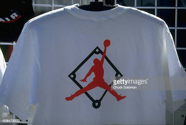 Closeup of tee shirts on vendor rack with Nike Jumpman logo over baseball diamond before Chicago White Sox vs Boston Red Sox spring training game at...