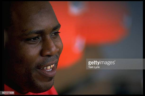 Closeup portrait of Cin Reds Kevin Mitchell alone happy in dugout before game