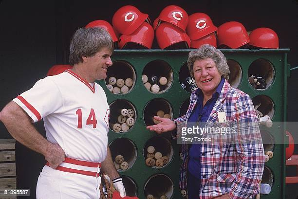 Baseball Closeup portrait of Cincinnati Reds owner Marge Schott in dugout with player and manager Pete Rose Cincinnati OH 6/9/1985