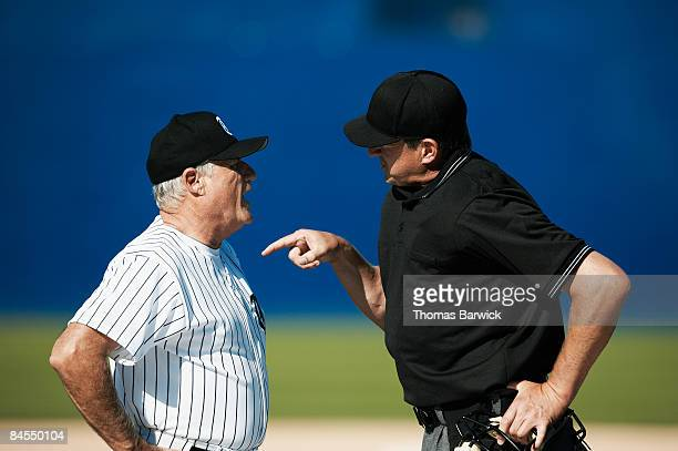 Baseball coach and umpire arguing