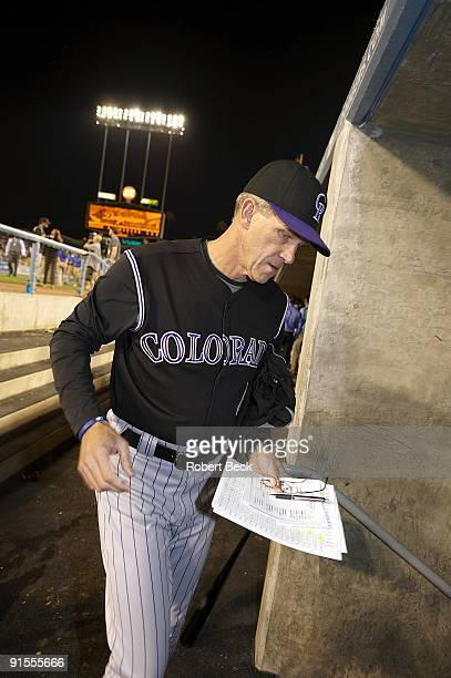 Colorado Rockies manager Jim Tracy holding lineup card in dugout during game vs Los Angeles Dodgers Los Angeles CA 10/2/2009 CREDIT Robert Beck
