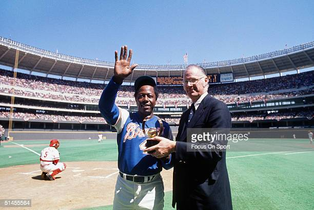 Baseball commisioner Bowie Kuhn presents outfielder Hank Aaron of the Atlanta Braves with an award at Riverfront Stadium during the 1970s in...