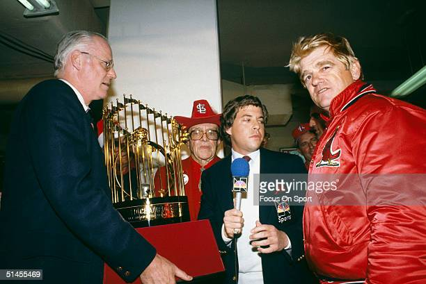 Baseball commissioner Bowie Kuhn presents St. Louis Cardinals owner August Busch and manager Whitey Herzog with the World Series trophy after winning...