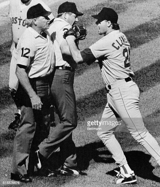 Baseball Commissioner Fay Vincent upheld roger Clemens' five game suspension and $10000 fine for his scuffle as shown here with home plate Umpire...