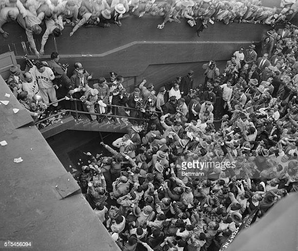 Baseball crowd at Ebbets Field, for the Giants vs. Dodgers playoff game. Bobby Thompson and Leo Durocher being mobbed.