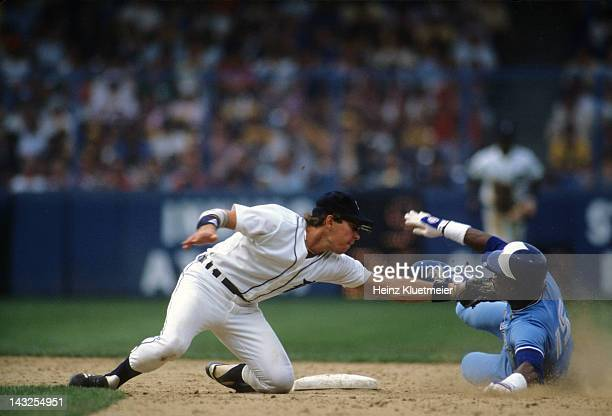 Detroit Tigers Alan Trammell in action tagging out Toronto Blue Jays Lloyd Moseby at second base at Tiger Stadium Detroit MI CREDIT Heinz Kluetmeier