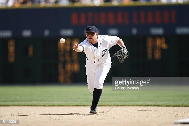 Baseball Detroit Tigers Chris Shelton in action making underhanded throw vs Oakland Athletics Detroit MI 7/22/2006