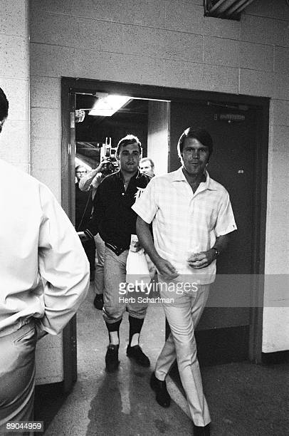 Detroit Tigers Denny McClain with celebrity musician Glen Campbell after game vs California Angels Anaheim CA 9/12/1968 CREDIT Herb Scharfman