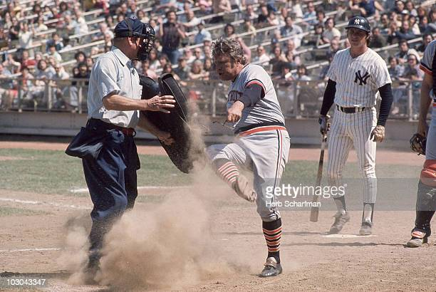 Detroit Tigers manager Ralph Houk upset, kicking dirt on AL home plate umpire Jim Odom during game vs New York Yankees. Flushing, NY 5/15/1974...
