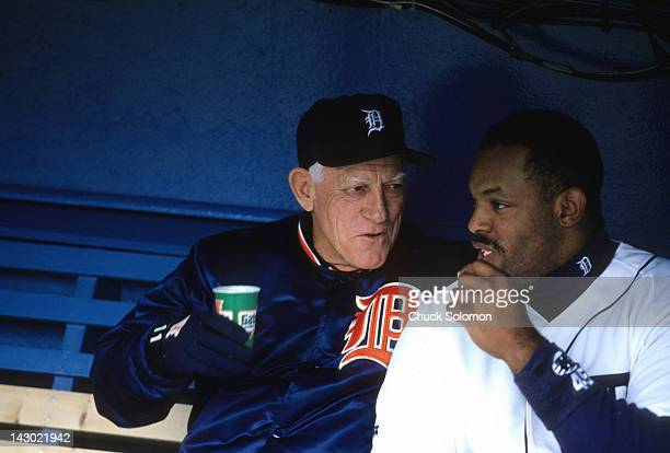 Detroit Tigers manager Sparky Anderson in dugout with Cecil Fielder during game vs California Angels at Tiger Stadium Detroit MI CREDIT Chuck Solomon