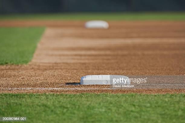 Baseball diamond (focus on base in foreground)