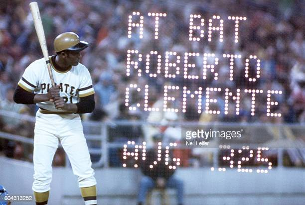 Double exposure view of Pittsburgh Pirates Roberto Clemente in action vs Los Angeles Dodgers at Three Rivers Stadium View of writing from scoreboard...