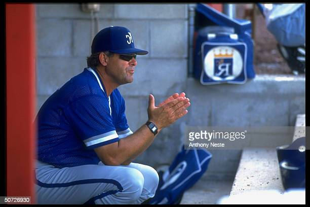 Exhibition. KC Royals manager Bob Boone alone, sitting in dugout during game.