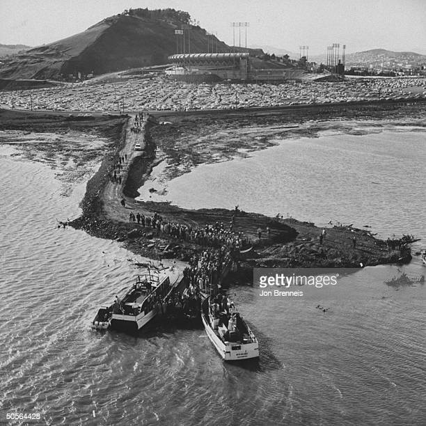 Exterior view of Candlestick park as boats bring fans in for opening day game vs St Louis Casrdinals
