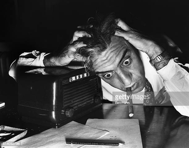 Baseball fan anxiously pulls at his hair as he listens to the first playoff game between the Brooklyn Dodgers and St. Louis Cardinals in St. Louis,...