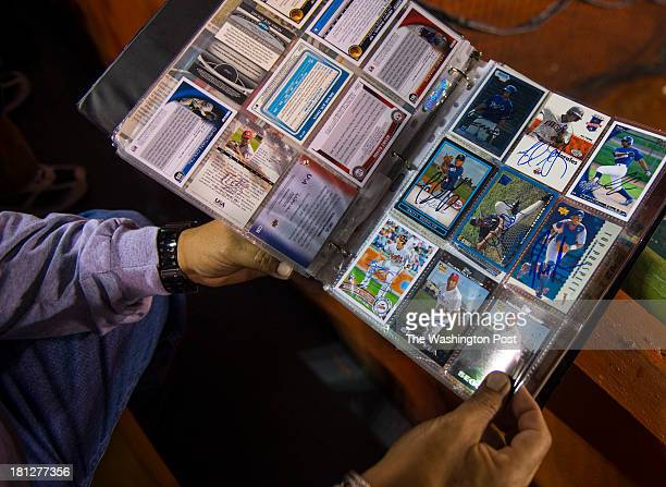 Baseball fan Edwin Pagan of Carolina shows his baseball card collection during a game between the Gigantes de Carolina and the Cangrejeros de...