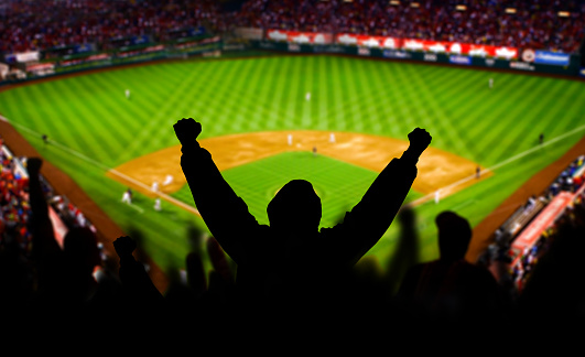 Baseball Fan Raising arms in Excitement 907917328