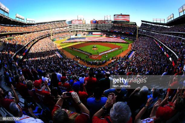 Baseball fans applaud at the end of the national anthem before the Cleveland Indians played the Texas Rangers on Opening Day at Globe Life Park in...