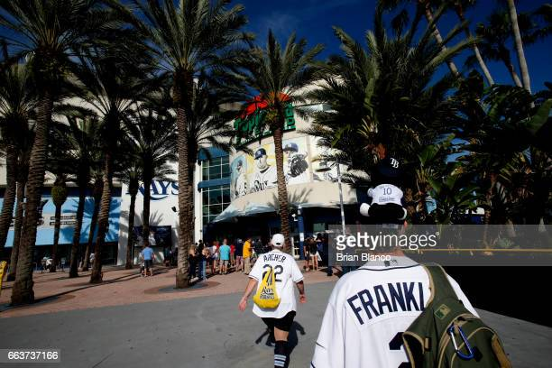 Baseball fans arrive for the first game of the season on Opening Day before the start of a game between the Tampa Bay Rays and the New York Yankees...