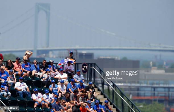 Baseball fans attend a game between the New York Mets and the Washington Nationals at Citi Field on June 18 2017 in the Flushing neighborhood of the...
