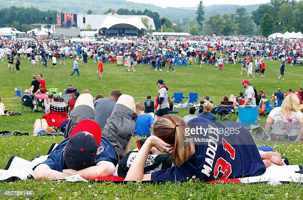 Baseball fans await the start of the Baseball Hall of Fame induction ceremony at Clark Sports Center during on July 27 2014 in Cooperstown New York