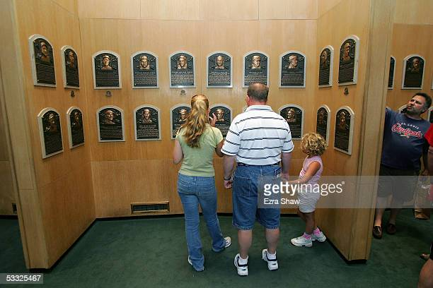 Baseball fans enjoy commemorative plaques at the induciton of 38 new members to the the National Baseball Hall of Fame and Museum on July 29 2005 in...