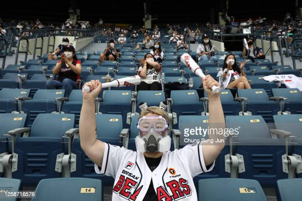 Baseball fans enjoy during the KBO League game between LG Twins and Doosan Bears at the Jamsil Stadium on July 26, 2020 in Seoul, South Korea. South...