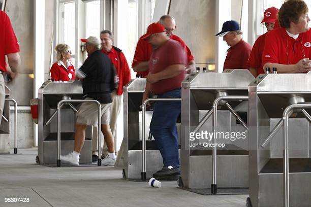 Baseball Fans kept the turnstiles spinning before the game between the St Louis Cardinals and the Cincinnati Reds at Great American Ball Park in...