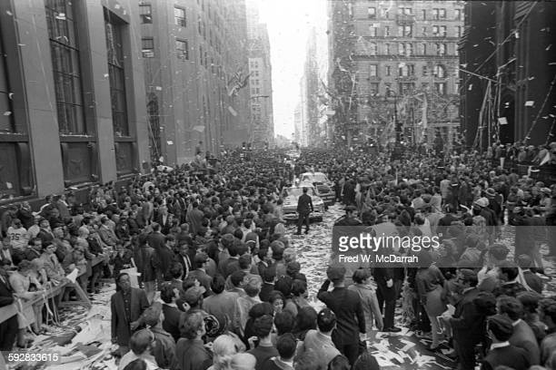Baseball fans line the street for a ticker tape parade in honor of the New York Mets baseball team and their 1969 World Series victory New York New...