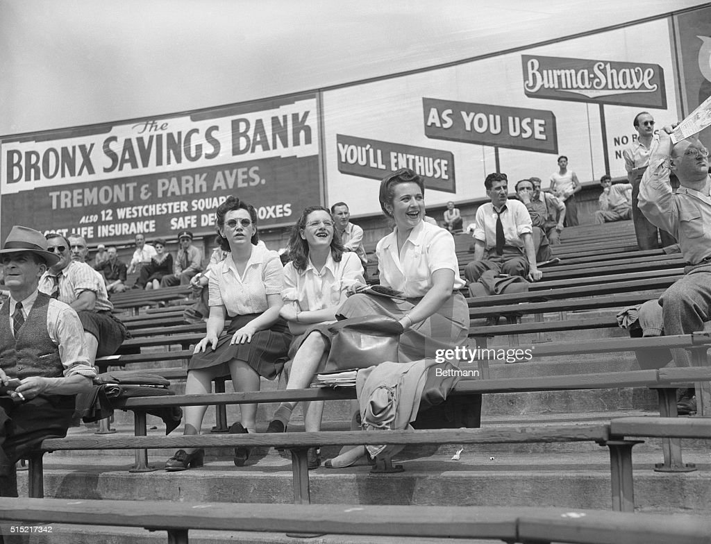 Baseball fans sit in the bleachers of Yankee Stadium in front of