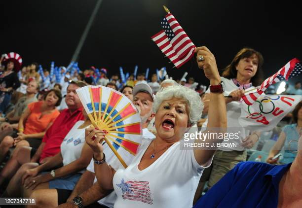 Baseball fans support their team in the opening game against South Korea in their men's preliminary round baseball game at the Wukesong Baseball...