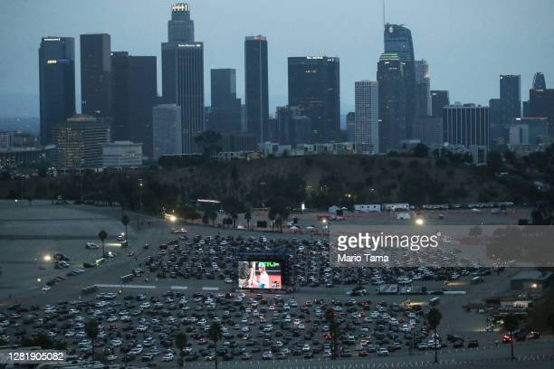 Baseball fans watch a drive-in screening of Game 3 of the 2020 World Series between the Los Angeles Dodgers and the Tampa Bay Rays at a Dodger...