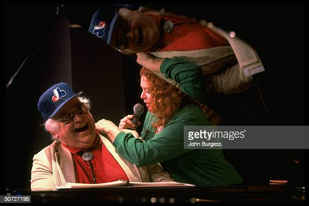 Feature Portrait of Montreal Expos John Wetteland's parents Ed playing piano and stepmother Barbara singing
