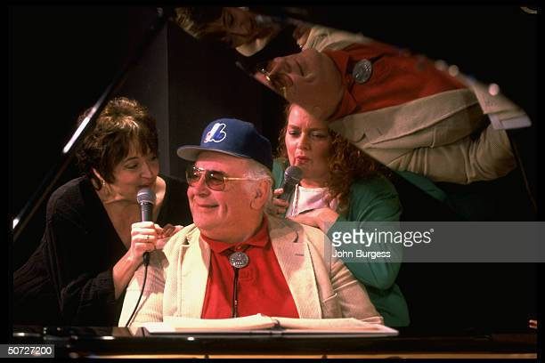 Feature Portrait of Montreal Expos John Wetteland's parents Ed playing piano and stepmother Barbara w unident friend singing