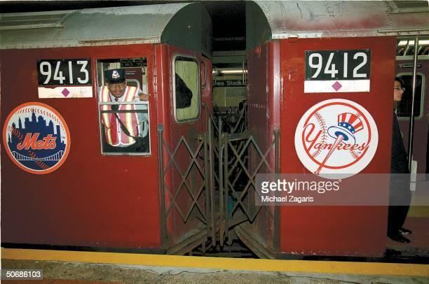Baseball Feature Portrait of number 7 subway train with New York Mets and New York Yankees logos as it pulls into Willets Point Shea Stadium station...