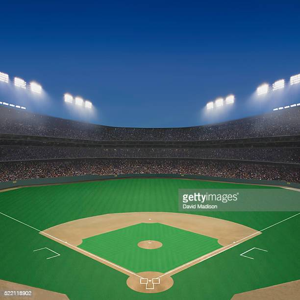 baseball field and stadium at twilight. - baseball diamond stock pictures, royalty-free photos & images