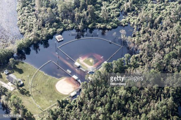 A baseball field covered in floodwater is seen in this aerial photograph taken above Willard North Carolina US on Friday Sept 21 2018 Record floods...
