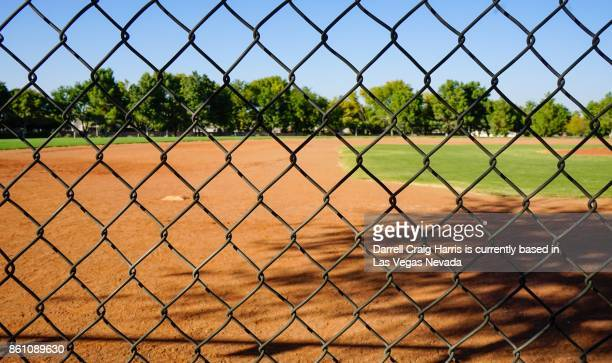 Baseball field with fence in foreground