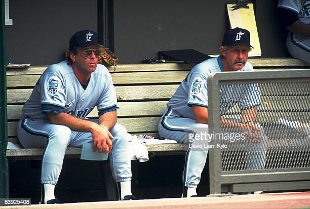 Florida Marlins manager Rene Lachemann with his brother pitching coach Marcel Lachemann in dugout during game vs Cincinnati Reds Cincinnati OH...
