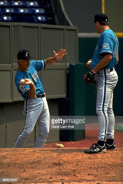 Florida Marlins pitching coach Marcel Lachemann demonstrating pitch to Pat Rapp while warming up in bullpen before game vs Cincinnati Reds Cincinnati...