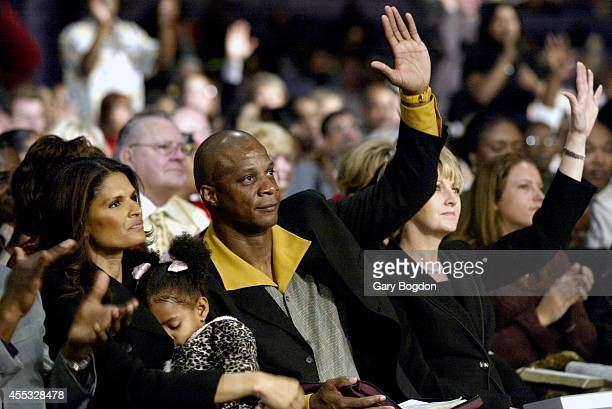 Former MLB outfielder Darryl Strawberry with wife Charisse and 3yearold daughter Jewel during services at Without Walls International Church Tampa FL...