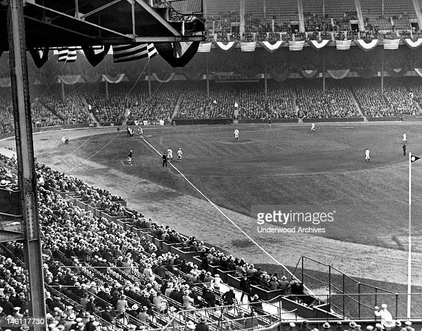 A baseball game at Yankee Stadium with Lou Gehrig at first base New York New York mid 1920s His number was the first number to be retired in any...